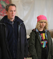Trollied. Image shows from L to R: Neville (Dominic Coleman), Sophie (Georgia Henshaw). Copyright: Roughcut Television.