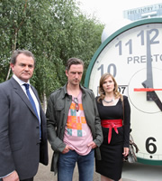 Twenty Twelve. Image shows from L to R: Ian Fletcher (Hugh Bonneville), Anthony Preston (Nicholas Gleaves), Siobhan Sharpe (Jessica Hynes). Copyright: BBC.