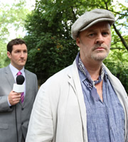 Twenty Twelve. Image shows from L to R: Reporter (John Hollingworth), Tony Ward (Tim McInnerny). Copyright: BBC.