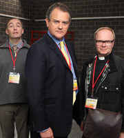 Twenty Twelve. Image shows from L to R: Mike Whitaker (Neil Edmond), Ian Fletcher (Hugh Bonneville), Richard Salter (Jason Watkins). Copyright: BBC.