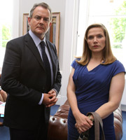 Twenty Twelve. Image shows from L to R: Ian Fletcher (Hugh Bonneville), Siobhan Sharpe (Jessica Hynes). Image credit: British Broadcasting Corporation.