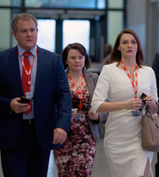 W1A. Image shows from L to R: Ian Fletcher (Hugh Bonneville), Tracey Pritchard (Monica Dolan), Anna Rampton (Sarah Parish). Copyright: BBC.