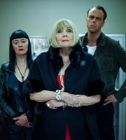 You, Me And The Apocalypse. Image shows from L to R: Larsson (Bronagh Gallagher), Sutton (Diana Rigg), Molby (Bruce Mackinnon). Copyright: Working Title Films / Bigballs Films.