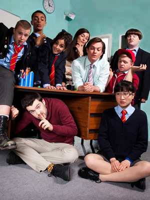 Bad Education. Image shows from L to R: Mitchell (Charlie Wernham), Stephen (Layton Williams), Alfie (Jack Whitehall), Chantelle (Nikki Runeckles), Miss Gulliver (Sarah Solemani), Fraser (Mathew Horne), Joe (Ethan Lawrence), Rem Dogg (Jack Binstead), Jing (Kae Alexander). Copyright: Tiger Aspect Productions.