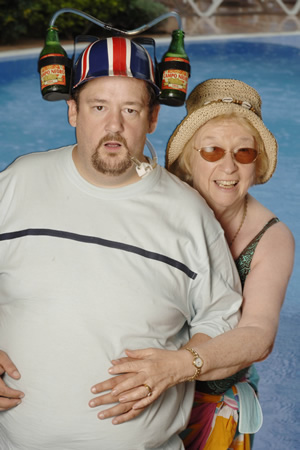 Benidorm. Image shows from L to R: The Oracle (Johnny Vegas), Noreen Maltby (Elsie Kelly). Image credit: Tiger Aspect Productions.