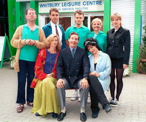 The Brittas Empire. Image shows from L to R: Colin Wetherby (Mike Burns), Helen Brittas (Pippa Haywood), Gavin Featherly (Tim Marriott), Gordon Brittas (Chris Barrie), Tim Whistler (Russell Porter), Carole (Harriet Thorpe), Linda (Jill Greenacre), Julie (Judy Flynn). Copyright: BBC.