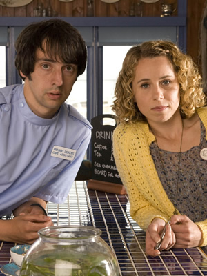 The Café. Image shows from L to R: Richard Dickens (Ralf Little), Sarah Porter (Michelle Terry). Copyright: Jellylegs.