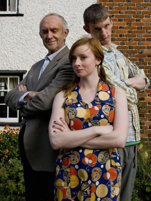 Clone. Image shows from L to R: Dr. Victor Blenkinsop (Jonathan Pryce), Rose Bourne (Fiona Glascott), Clone (Stuart McLoughlin). Copyright: Roughcut Television.