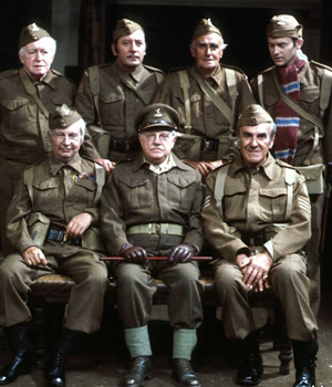 Dad's Army. Image shows from L to R: Private Godfrey (Arnold Ridley), Lance Corporal Jones (Clive Dunn), Private Walker (James Beck), Captain Mainwaring (Arthur Lowe), Private Frazer (John Laurie), Sergeant Wilson (John Le Mesurier), Private Pike (Ian Lavender). Image credit: British Broadcasting Corporation.