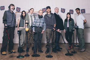 Detectorists. Image shows from L to R: Russell (Pearce Quigley), Varde (Orion Ben), Louise (Laura Checkley), Lance Stater (Toby Jones), Andy Stone (Mackenzie Crook), Terry (Gerard Horan), Sophie (Aimee-Ffion Edwards), Hugh (Divian Ladwa). Copyright: Channel X / Lola Entertainment.