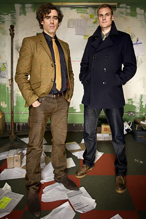 Dirk Gently. Image shows from L to R: Dirk Gently (Stephen Mangan), Richard MacDuff (Darren Boyd). Copyright: ITV Studios / The Welded Tandem Picture Company.