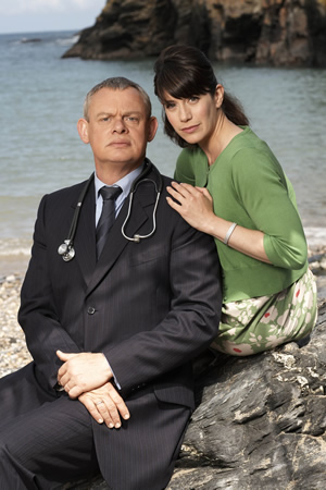 Doc Martin. Image shows from L to R: Dr Martin Ellingham (Martin Clunes), Louisa Glasson (Caroline Catz). Image credit: Buffalo Pictures.
