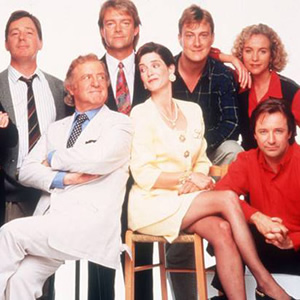 Drop The Dead Donkey. Image shows from L to R: George Dent (Jeff Rawle), Henry Davenport (David Swift), Gus Hedges (Robert Duncan), Sally Smedley (Victoria Wicks), Damien Day (Stephen Tompkinson), Helen Cooper (Ingrid Lacey), Dave Charnley (Neil Pearson). Image credit: Hat Trick Productions.