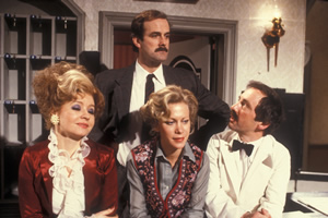 Fawlty Towers. Image shows from L to R: Sybil Fawlty (Prunella Scales), Basil Fawlty (John Cleese), Polly (Connie Booth), Manuel (Andrew Sachs). Copyright: BBC.