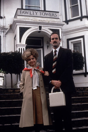 Fawlty Towers. Image shows from L to R: Sybil Fawlty (Prunella Scales), Basil Fawlty (John Cleese). Copyright: BBC.