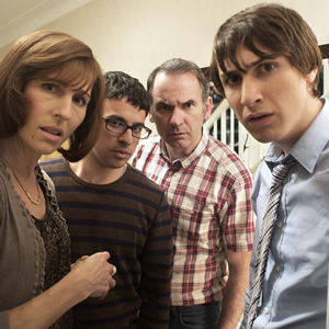 Friday Night Dinner. Image shows from L to R: Jackie (Tamsin Greig), Adam (Simon Bird), Martin (Paul Ritter), Jonny (Tom Rosenthal). Copyright: Popper Pictures / Big Talk Productions.