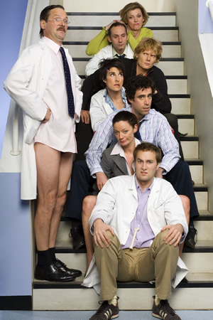 Green Wing. Image shows from L to R: Alan Statham (Mark Heap), Joanna Clore (Pippa Haywood), Martin Dear (Karl Theobald), Mac Macartney (Julian Rhind-Tutt), Caroline Todd (Tamsin Greig), Guy Secretan (Stephen Mangan), Sue White (Michelle Gomez), Boyce (Oliver Chris). Image credit: Talkback Productions.