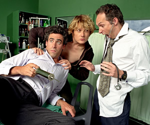 Green Wing. Image shows from L to R: Guy Secretan (Stephen Mangan), Mac Macartney (Julian Rhind-Tutt), Martin Dear (Karl Theobald). Image credit: Talkback Productions.