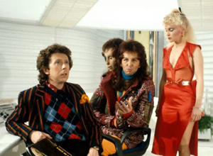 The Hitchhiker's Guide To The Galaxy. Image shows from L to R: Ford Prefect (David Dixon), Zaphod Beeblebrox (Mark Wing-Davey), Trillian (Sandra Dickinson). Image credit: British Broadcasting Corporation.