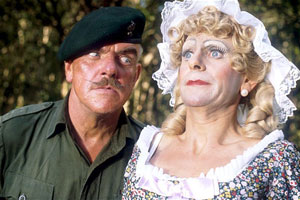 It Ain't Half Hot Mum. Image shows from L to R: BSM 'Shut Up' Williams (Windsor Davies), Bombardier 'Gloria' Beaumont (Melvyn Hayes). Copyright: BBC.