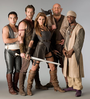 Krod Mandoon And The Flaming Sword Of Fire. Image shows from L to R: Bruce (Marques Ray), Krod Mandoon (Sean Maguire), Aneka (India de Beaufort), Loquasto (Steve Speirs), Zezelryck (Kevin Hart). Copyright: Hat Trick Productions / Comedy Central.