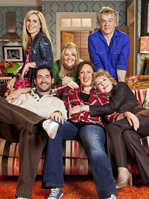 Miranda. Image shows from L to R: Tilly (Sally Phillips), Gary (Tom Ellis), Stevie (Sarah Hadland), Miranda (Miranda Hart), Penny (Patricia Hodge), Clive (James Holmes). Image credit: British Broadcasting Corporation.
