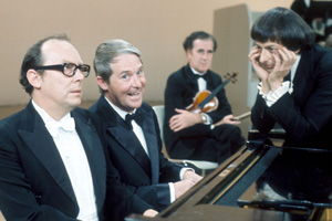 The Morecambe & Wise Show. Image shows from L to R: Eric Morecambe, Ernie Wise, Andre Previn. Copyright: BBC.