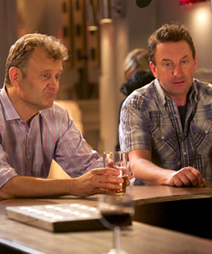 Not Going Out. Image shows from L to R: Toby (Hugh Dennis), Lee (Lee Mack). Copyright: Avalon Television / Arlo Productions.