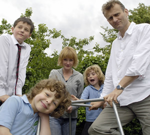 Outnumbered. Image shows from L to R: Jake (Tyger Drew-Honey), Ben (Daniel Roche), Sue (Claire Skinner), Karen (Ramona Marquez), Pete (Hugh Dennis). Copyright: Hat Trick Productions.