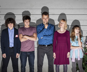 Outnumbered. Image shows from L to R: Ben (Daniel Roche), Jake (Tyger Drew-Honey), Pete (Hugh Dennis), Sue (Claire Skinner), Karen (Ramona Marquez). Image credit: Hat Trick Productions.