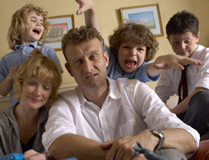 Outnumbered. Image shows from L to R: Karen (Ramona Marquez), Sue (Claire Skinner), Pete (Hugh Dennis), Ben (Daniel Roche), Jake (Tyger Drew-Honey). Image credit: Hat Trick Productions.