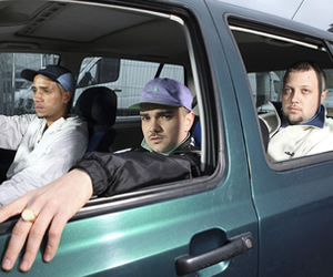 People Just Do Nothing. Image shows from L to R: Decoy (Daniel Sylvester Woolford), Grindah (Allan Mustafa), Beats (Hugo Chegwin). Copyright: Roughcut Television.