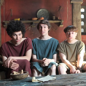 Plebs. Image shows from L to R: Stylax (Joel Fry), Marcus (Tom Rosenthal), Grumio (Ryan Sampson). Copyright: RISE Films.