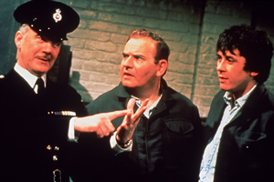 Porridge. Image shows from L to R: Mr. Mackay (Fulton Mackay), Fletcher (Ronnie Barker), Godber (Richard Beckinsale). Image credit: British Broadcasting Corporation.