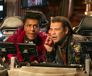Red Dwarf. Image shows from L to R: Cat (Danny John-Jules), Lister (Craig Charles). Copyright: Grant Naylor Productions / BBC.