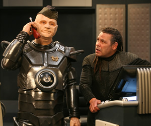 Red Dwarf. Image shows from L to R: Kryten (Robert Llewellyn), Lister (Craig Charles). Copyright: Grant Naylor Productions / BBC.