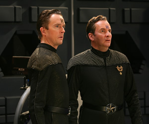 Red Dwarf. Image shows from L to R: Howard Rimmer (Mark Dexter), Rimmer (Chris Barrie). Copyright: Grant Naylor Productions / BBC.