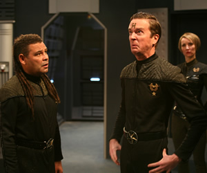 Red Dwarf. Image shows from L to R: Lister (Craig Charles), Howard Rimmer (Mark Dexter), Sim Crawford (Susan Earl). Copyright: Grant Naylor Productions / BBC.