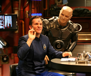 Red Dwarf. Image shows from L to R: Rimmer (Chris Barrie), Kryten (Robert Llewellyn). Copyright: Grant Naylor Productions / BBC.
