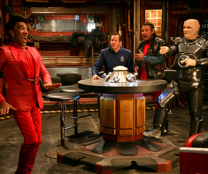 Red Dwarf. Image shows from L to R: Cat (Danny John-Jules), Rimmer (Chris Barrie), Lister (Craig Charles), Kryten (Robert Llewellyn). Copyright: Grant Naylor Productions / BBC.