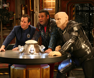 Red Dwarf. Image shows from L to R: Rimmer (Chris Barrie), Lister (Craig Charles), Kryten (Robert Llewellyn). Copyright: Grant Naylor Productions / BBC.