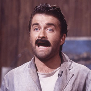Harry Enfield as Stavros. Copyright: London Weekend Television.