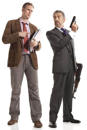 Spy. Image shows from L to R: Tim (Darren Boyd), The Examiner (Robert Lindsay). Image credit: Hat Trick Productions.
