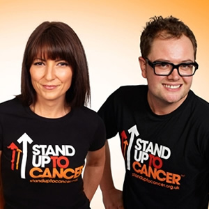 Stand Up To Cancer 2012. Image shows from L to R: Davina McCall, Alan Carr. Image credit: Channel 4.