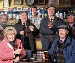 Still Game. Image shows from L to R: Navid Harrid (Sanjeev Kohli), Isa Drennan (Jane McCarry), Jack Jarvis (Ford Kiernan), Boaby (Gavin Mitchell), Victor McDade (Greg Hemphill), Tam Mullen (Mark Cox), Winston Ingram (Paul Riley). Image credit: The Comedy Unit.