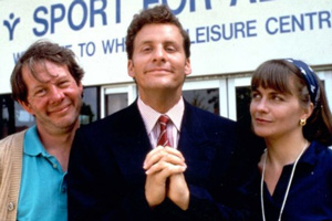 The Brittas Empire. Image shows from L to R: Colin Wetherby (Mike Burns), Gordon Brittas (Chris Barrie), Laura Lancing (Julia St. John). Copyright: BBC.