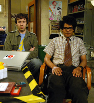 The IT Crowd. Image shows from L to R: Roy (Chris O'Dowd), Moss (Richard Ayoade). Image credit: TalkbackThames.