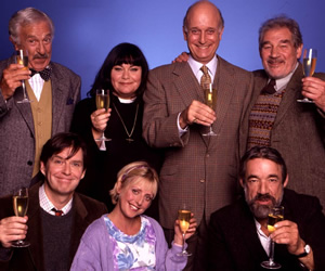 The Vicar Of Dibley. Image shows from L to R: Frank Pickle (John Bluthal), Hugo Horton (James Fleet), Geraldine Grainger (Dawn French), Alice Tinker (Emma Chambers), David Horton (Gary Waldhorn), Owen Newitt (Roger Lloyd-Pack), Jim Trott (Trevor Peacock). Image credit: Tiger Aspect Productions.