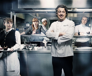 Whites. Image shows from L to R: Kiki (Isy Suttie), Caroline (Katherine Parkinson), Axel (Amit Shah), Roland White (Alan Davies), Bib Spears (Darren Boyd). Copyright: BBC.