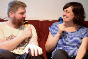 2 Standup Comedians Living In A Flat. Image shows from L to R: Will (William Sirl), Lyns (Lynsey Bonell).